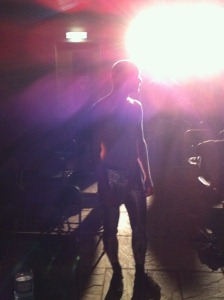 picture of Alex Swift in silhouette, wearing sparkly leggings